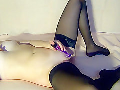 my younger stepsister in stockings, masturbates with dildo on camera